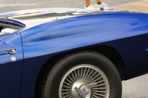Back tire and trunk of a beautiful blue classic car