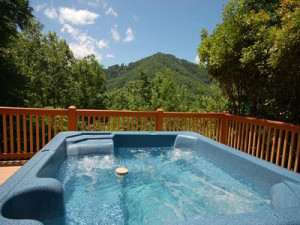 Incredible mountain view from the hot tub on the deck of the Serenity View cabin in Pigeon Forge.