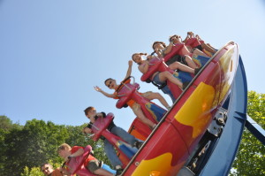 kid standing on ride at Dollywood