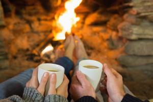 couple enjoying fireplace in Pigeon Forge vacation home rentals