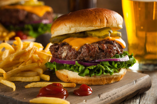 Tasty cheeseburger with french fries.