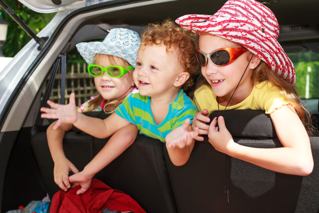 kids in a car on the way to a fall Smoky Mountain vacation